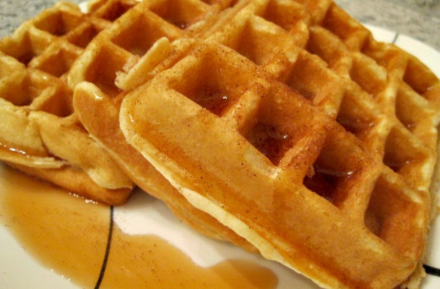 Homemade Belgian Waffles topped with coconut oil, cinnamon, and syrup.